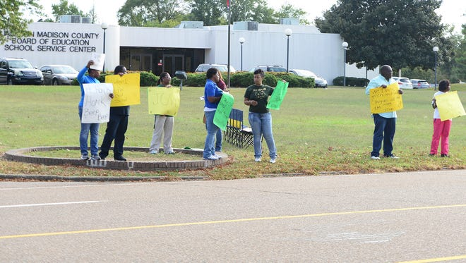 Jackson Central-Merry High School alumni protest outside of the Jackson-Madison County Board of Education office on Monday afternoon.