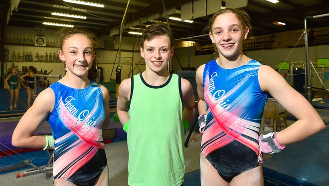 From left, Makenzie Fitzgerald of River Valley, Brody McDonald of Grant Middle School and Ontario's Jen Crum, who all are Mid Ohio Gymnastics competitors, will participate in national meets over the next two weekends.