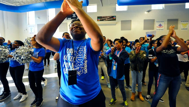 Maleek McLaurin,, 17, leads fellow Helen Thackston Charter School students in the Cha-Cha Slide as student leaders hold a Patriot Pride spirit rally, Friday, Feb. 24, 2017. Students with acceptable progress reports were invited to the rally where they were treated to a three-point basketball shoot off, demonstrations by the cheerleaders and drum line, and dancing.  John A. Pavoncello photo