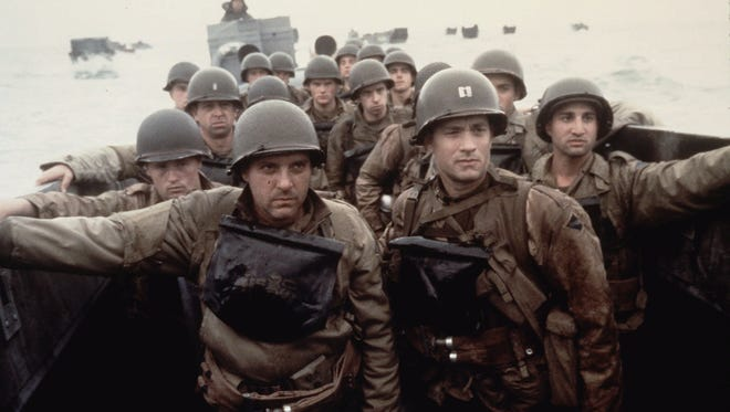 """Tom Hanks (right) and Tom Sizemore play soldiers getting ready to hit the beach at Normandy in """"Saving Private Ryan."""""""
