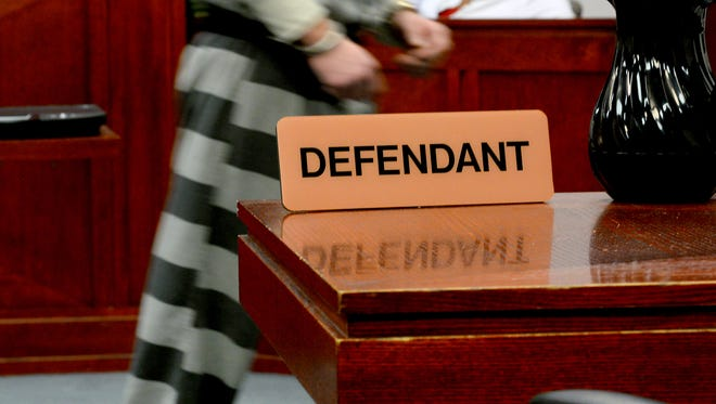A defendant leaves a courtroom at the Veterans Memorial Courthouse in downtown Lansing on Tuesday, Nov. 1, 2016.