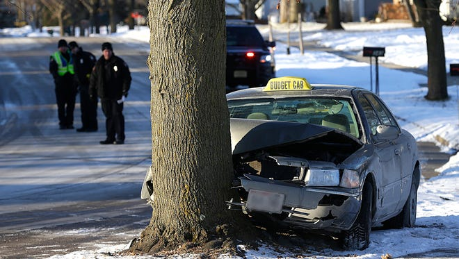 City of Fond du Lac Police investigate a crash Thursday January 4, on Hawthorne Drive in the city of Fond du Lac. A taxi veered off the road and struck a tree.