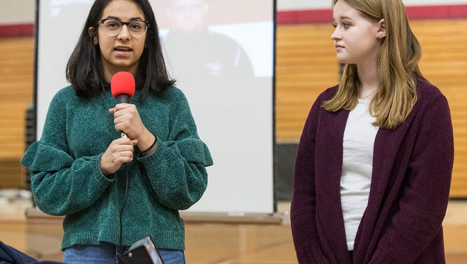 Fond du Lac High School Sophmore Mohini Kumar and Junior Breanna Schmoldt lead an assembly of about 500 students Wednesday March 14, 2018 at Fond du Lac High School leading into a 17 minute moment of scilence walk-out of school. One minute for each person killed in a school shooting in Florida February 14th. Doug Raflik/USA TODAY NETWORK-Wisconsin