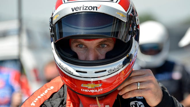 Team Penske IndyCar driver Will Power (12) celebrate won the Indy 500 Pit Stop Challenge during Carb Day practice at the Indianapolis Motor Speedway Friday, May 26, 2017.