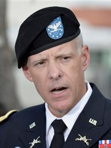 Col. Daniel J.W. King, U.S. Army Forces Command Director of Public Affairs, speaks to members of the media after the Article 32 preliminary hearing to determine if Army Sgt. Bowe Bergdahl should face a court-martial, Thursday, Sept. 17, 2015, at Fort Sam Houston in San Antonio. Bergdahl, who left his post in Afghanistan and was held by the Taliban for five years, is charged with desertion and misbehavior before the enemy. (AP Photo/Darren Abate)