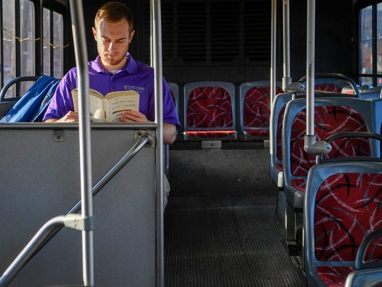 Kyle Neal reads as he rides to Vanderbilt on Bus 7