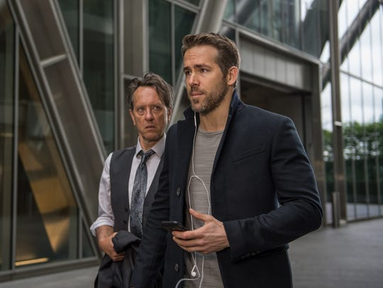 """Richard E. Grant (left) and Ryan Reynolds star in """"The"""