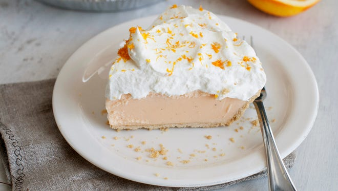 Orange-vanilla ice cream pie with orange whipped cream in Concord, N.H. on July 21, 2014. The dish offers the creamy-sweet richness of a Creamsicle.