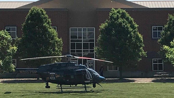A police helicopter is seen on the lawn at Noblesville