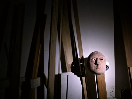A mask and other Halloween decorations are seen in