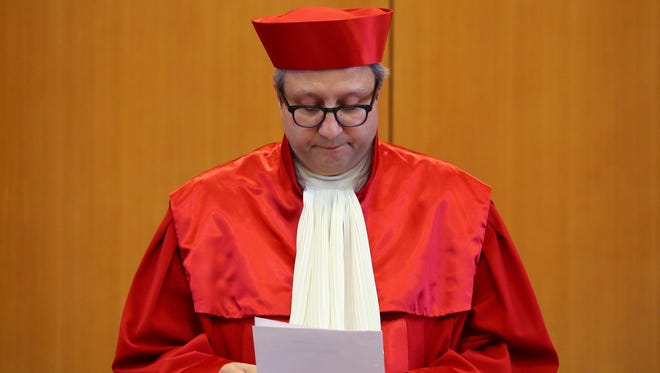 The President of Germany's Constitutional Court Andreas Vosskuhle reads the verdict on an attempt to ban the far-right NPD party at the Federal Constitutional Court in Karlsruhe, southwestern Germany, on Jan. 17, 2017.