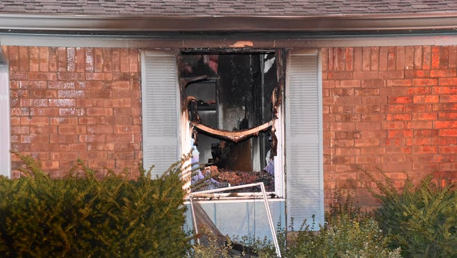 Flames were showing from the front of the single-story house, when firefighters arrived shortly before 1 a.m.