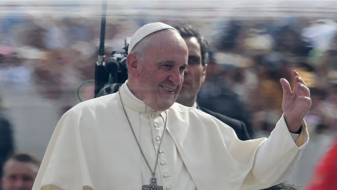 Pope Francis waves to faithfuls upon his arrival at Saint Peter square to lead his weekly general audience on Sept. 21, 2016 in the Vatican.