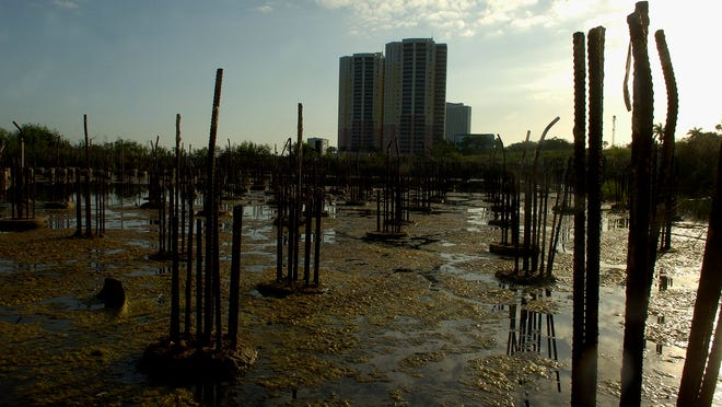 The Cypress Club condominium building site sits empty along the Caloosahatchee River in Fort Myers on Monday April 27, 2009. Investors are suing the owner claiming that the project will not be completed by its contractual deadline.