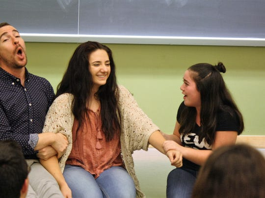 Stephen Agosto, program director for Rutgers High School Musical Theater Academy, instructs Alaina Stampe, 17 of Upper Freehold (center) and Robyn Wasserman, 15 of Branchburg.
