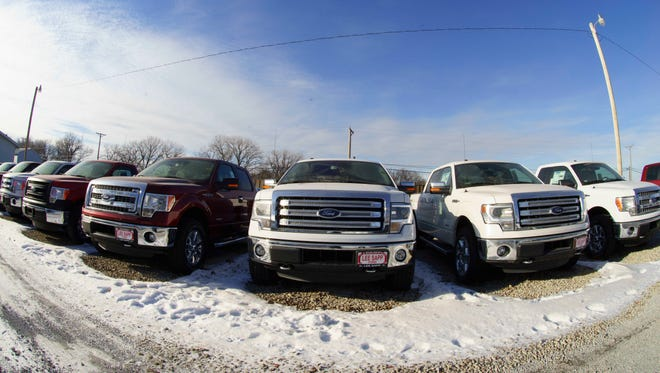 Ford F-150 pickup trucks are lined up at the Lee Sapp Ford dealership in Ashland, Neb.