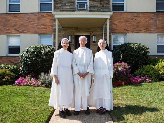 The nuns at Caterina Benincasa Dominican Monastery at Holy Spirit Church: Sister Emmanuella Handlos (left), Sister Mary Grace Thul (center) and Sister Mary Columba Brienza (right).