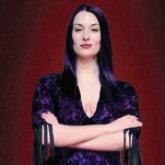 """Erin Cohenour stars as Morticia Addams in Beef & Boards Dinner Theatre's production of """"The Addams Family,"""" running Oct. 8-Nov. 22, 2015."""