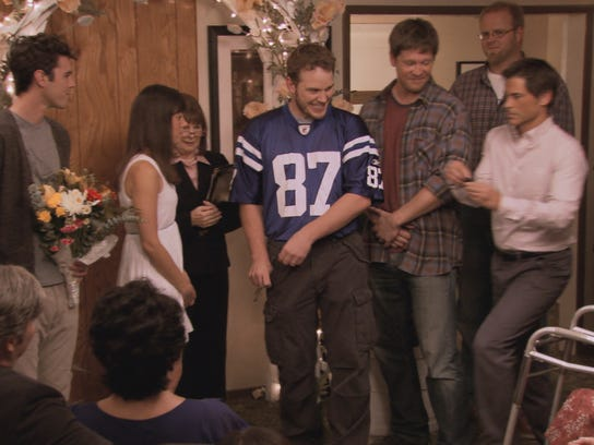 Andy Dwyer gets married in a Reggie Wayne jersey.