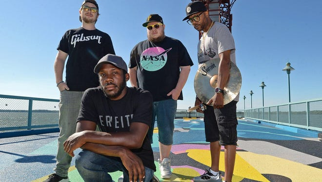 """The CEE Brown Experience, shown Tuesday at Dobbins Landing in Erie, blends hip hop, blues and funk and will be performing in the virtual Erie's Blues & Jazz Festival in August. The members are, from left: Eric Brewer, Charles Brown, Ralph Reitinger III, and Ken """"Stix"""" Thompson."""
