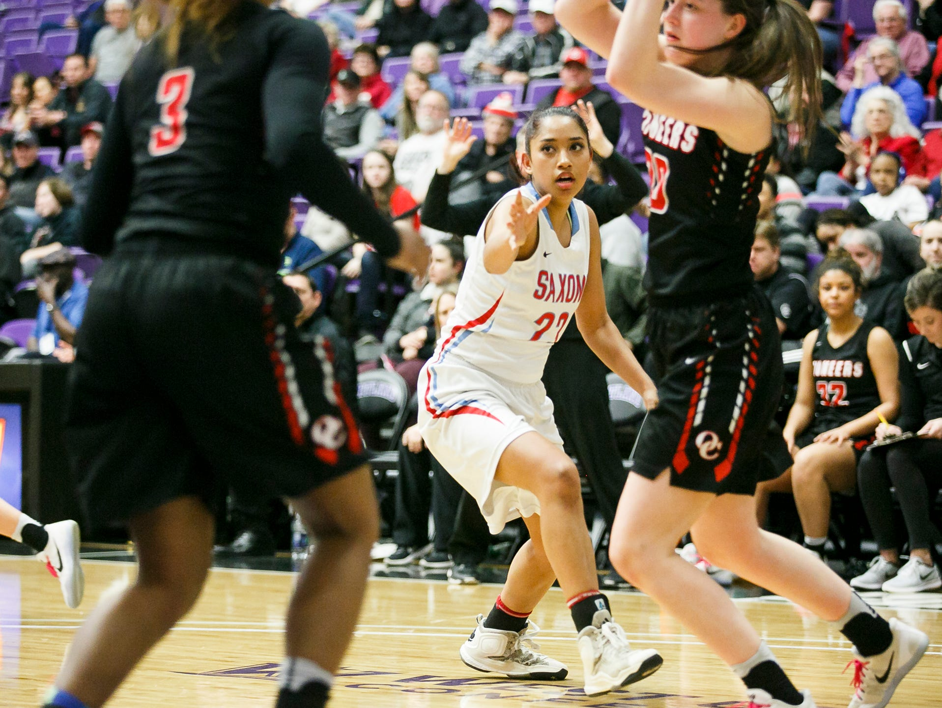 South Salem's Dani Harley tries to block a pass between Oregon City players in the OSAA 6A semifinal state championships on Friday, March 10, 2017, at the University of Portland. South Salem lost 46-54.