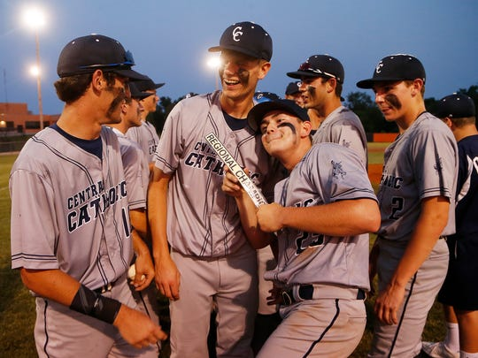 Jacob Marin and his Central Catholic teammates celebrate after defeating Frankton 3-2 in the championship of the Class 2A baseball regional Saturday, June 2, 2018, in Wabash. CC defeated Frankton 3-1.
