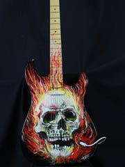 Local artists transformed stringed instruments into works of art, which are up for auction to help raise money for the Chatfield Project. The nine-piece collection of hand-painted instruments includes a heavy metal painted electric guitar by renowned Waukesha artist Tom Noll.