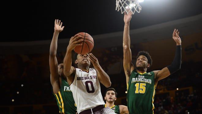 Arizona State Sun Devils guard Tra Holder (0) goes up for a layup against San Francisco Dons guard Jamaree Bouyea (1) and forward Nate Renfro (15) during the first half at Wells-Fargo Arena.