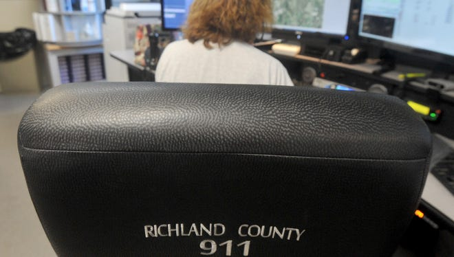Nancy Daugherty mans her station as she answers 911 calls for the Richland County Sheriff's Office on Monday.