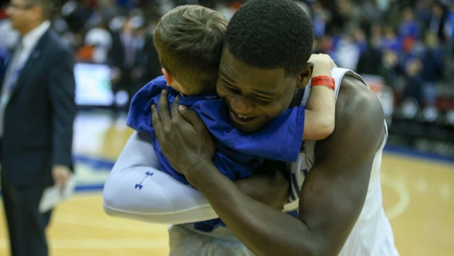 Seton Hall's Angel Delgado embraces a young fan after the Pirates beat Marquette Jan. 1.
