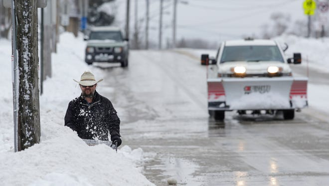 Todd Gaudette clears his driveway with a snowblower during a winter storm Sunday, Apr. 15, 2018, in Manitowoc, Wis. Josh Clark/USA TODAY NETWORK-Wisconsin