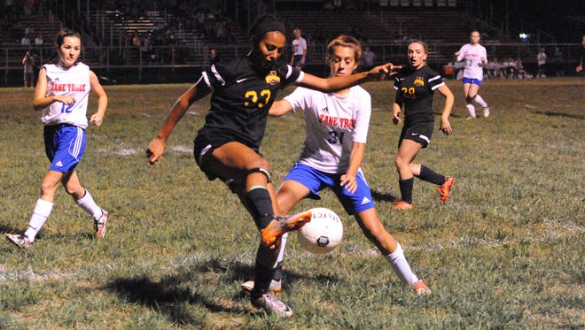 Unioto's Caleah Beatty gains possession of the ball while being defended by Zane Trace's Shalyn Penrod Tuesday night in Kinnikinnick. The Shermans defeated the Pioneers 4-0.