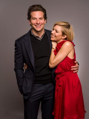 Bradley Cooper and Sienna Miller share a laugh in November in New York City.