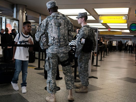 Soldiers stand guard LaGuardia Airport in New York