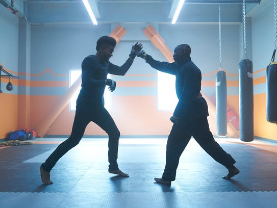 Priest (Trevor Jackson, left) spars with his boss,