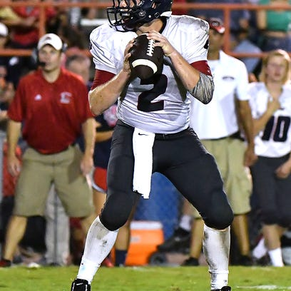 Creek Wood quarterback Devon Higgins sets up in the pocket against Dickson County.
