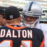 Oakland Raiders quarterback Carson Palmer congratulates Andy Dalton after the Bengals defeated the Raiders 34-10 at Paul Brown Stadium in Palmer's return in 2012.