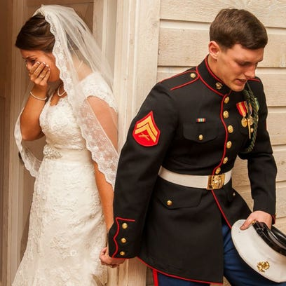 U.S. Marine Cpl. Caleb Earwood poses with his bride-to-be Maggie in Asheville, North Carolina.