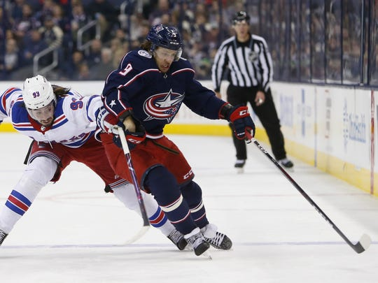 Columbus Blue Jackets' Artemi Panarin, right, of Russia, carries the puck across the blue line as New York Rangers' Mika Zibanejad, of Sweden, pursues during the second period of an NHL hockey game Sunday, Jan. 13, 2019, in Columbus, Ohio. (AP Photo/Jay LaPrete)