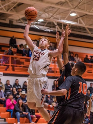Aztec's Chase Morrison attacks the basket for a layup against Gallup on Thursday at Lillywhite Gym in Aztec.