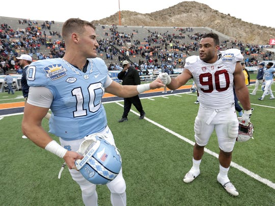 North Carolina quarterback Mitch Trubisky and Stanford defensive lineman Solomon Thomas congratulate one another following the 83rd Sun Bowl NCAA college football game Friday, Dec., 30, 2016 in El Paso, Texas. Stanford defeated North Carolina 25-23.
