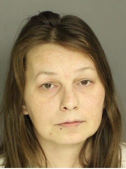Wendy Rhone, is charged with possession of heroin and drug paraphernalia.