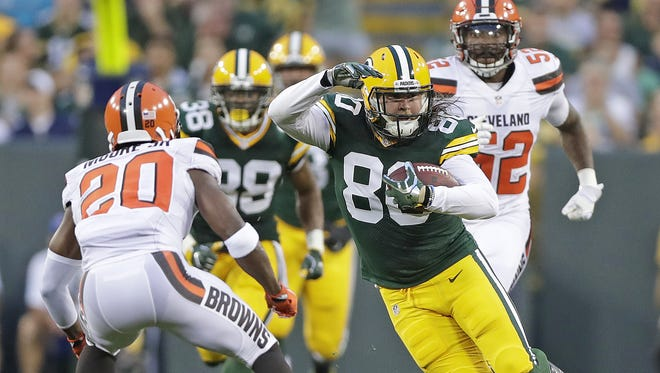 Green Bay Packers tight end Justin Perillo (80) runs at defensive back Rahim Moore (20) after a catch against the Cleveland Browns at Lambeau Field.