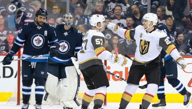 Vegas Golden Knights forward David Perron (57) celebrates his overtime goal against the Winnipeg Jets at Bell MTS Place.