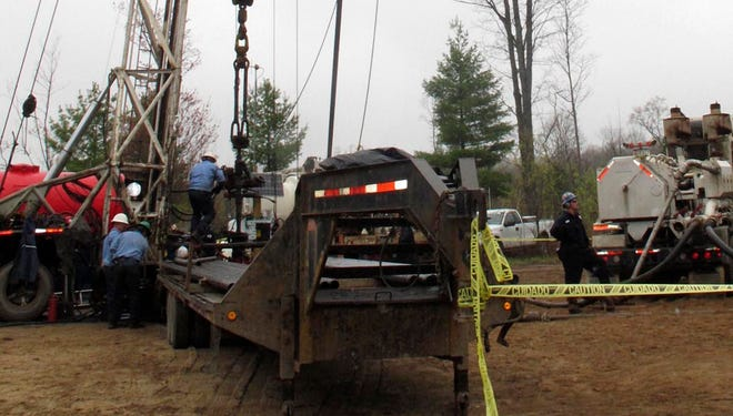 In this May 19, 2011 photo, crews prepare to pump water and chemicals into a natural gas well in Charlton Township, Mich., to release additional gas from shale formations 1,200 feet beneath the earthís surface.