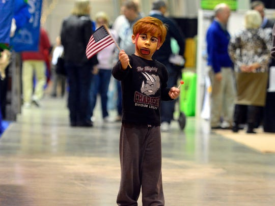 Julian Cejas, 4 of York Springs, sports Iron Man face paint while waving his flag at the York Builders Association Home & Garden Show, Sunday January 31, 2016. John A. Pavoncello photo