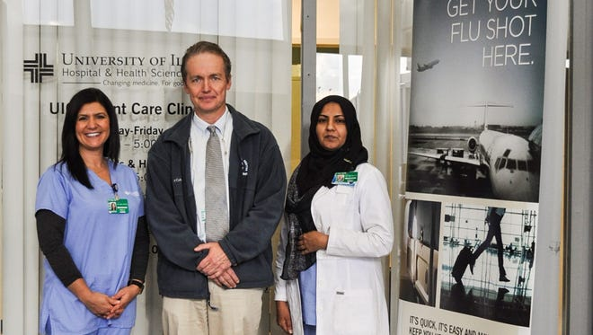 Dr. John Zautcke with UIC Clinic radiographers Rose Ferri and Saman Idri.