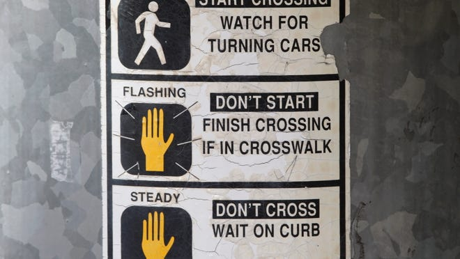 A handy guide for those who don't understand crosswalk signals. Photographed on Friday.