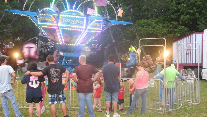 Attendees enjoy carnival rides at this year's Stewart Heritage Festival.