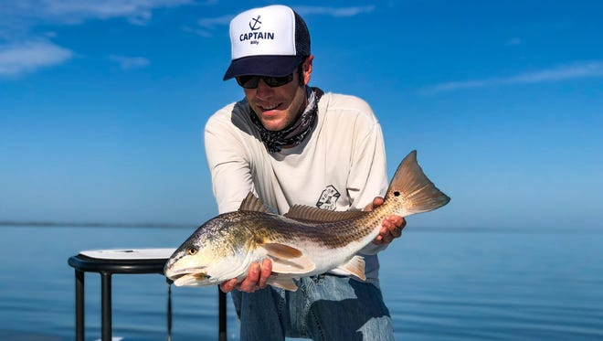 Capt. Billy Rotne of Tail Hunter charters based out of New Smyrna Beach with a redfish he caught and released recently in the Mosquito Lagoon.